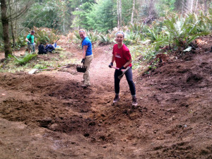 Kory Bisset assisting Alexis Neuman with shaping her namesake trail feature.